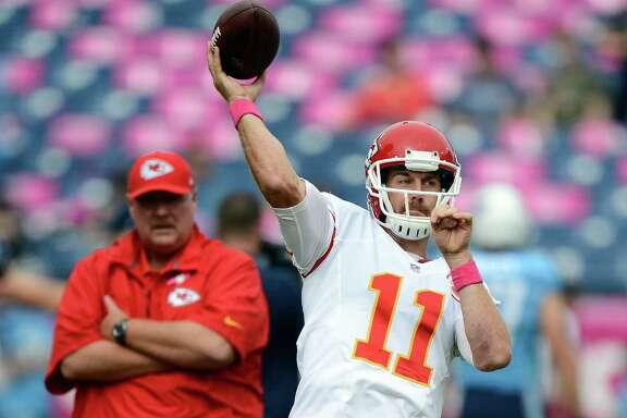 Kansas City Chiefs coach Andy Reid, left, and quarterback Alex Smith have earned plenty of credit for a 6-0 start and erasing Texans fans' thoughts of an easy win.
