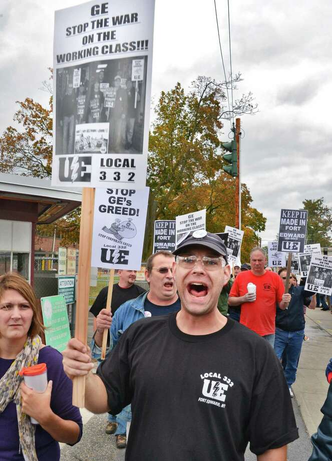 Roger Harrington, a Fort Edward plant worker of eight years, chants union slogans as he and other union workers protest GE's plans to close the plant Friday, Oct. 18, 2013, in Fort Edward, N.Y.  (John Carl D'Annibale / Times Union archive) Photo: John Carl D'Annibale / 00024268A