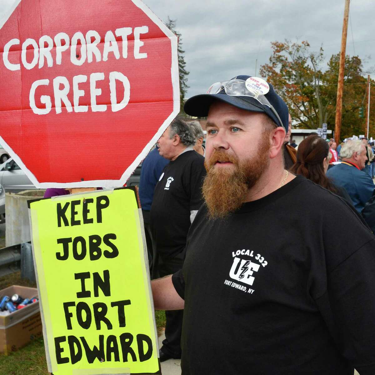 Roger Harrington, a Fort Edward assembly worker of 10 years, carries a sign as he and other union workers protest GE's plans to close the plant Friday afternoon, Oct. 18, 2013, in Fort Edward, N.Y. (John Carl D'Annibale / Times Union)