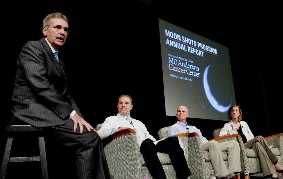 M.D. Anderson Cancer Center President Ronald DePinho, left, address the audience Friday about the Moon Shots program, an initiative to fight eight rare forms of the disease. Jho Low, CEO of Jynwel Capital Limited, donated $50 million to the project. Photo: Marie D. De Jeséºs, Staff / © 2013 Houston Chronicle