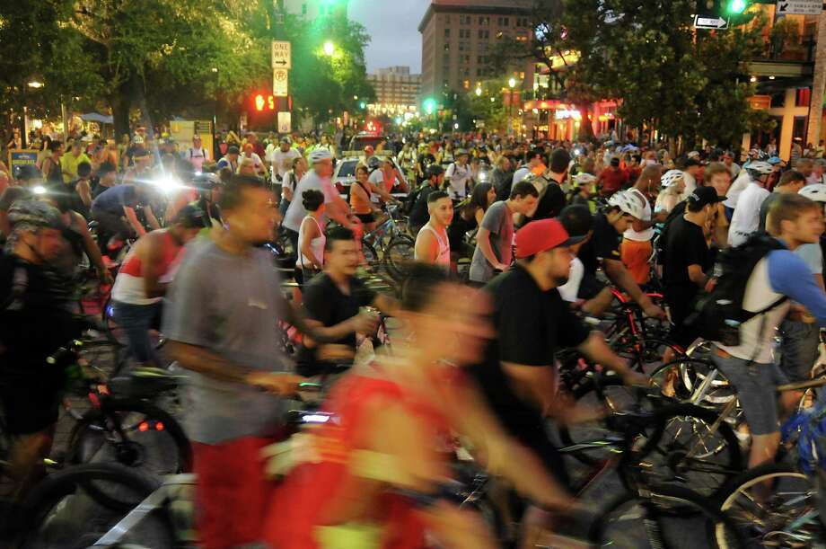 Bikers gather near Market Square downtown for September's Critical Mass bike ride. Many drivers see the rally as a nuisance.  Bikers gather near Market Square downtown for September's Critical Mass bike ride. Many drivers see the rally as a nuisance. Photo: Dave Rossman, Freelance / © 2013 Dave Rossman