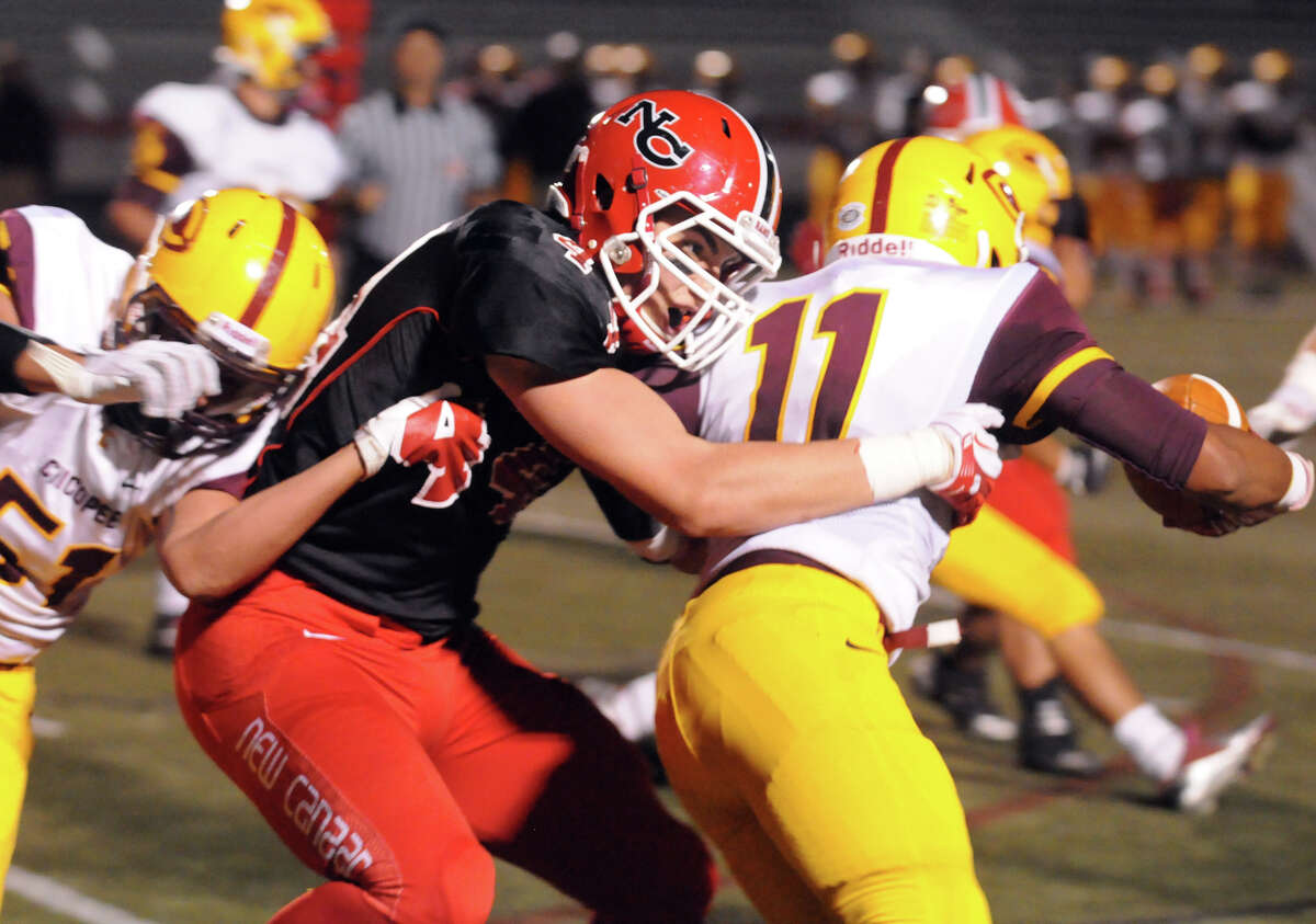 New Canaan's Zach Allen stops Chicopee's Joshua Malone as the New Canaan High School Rams hosts the Chicopee High Pacers in a football game in New Canaan, Conn., Oct. 18, 2013.