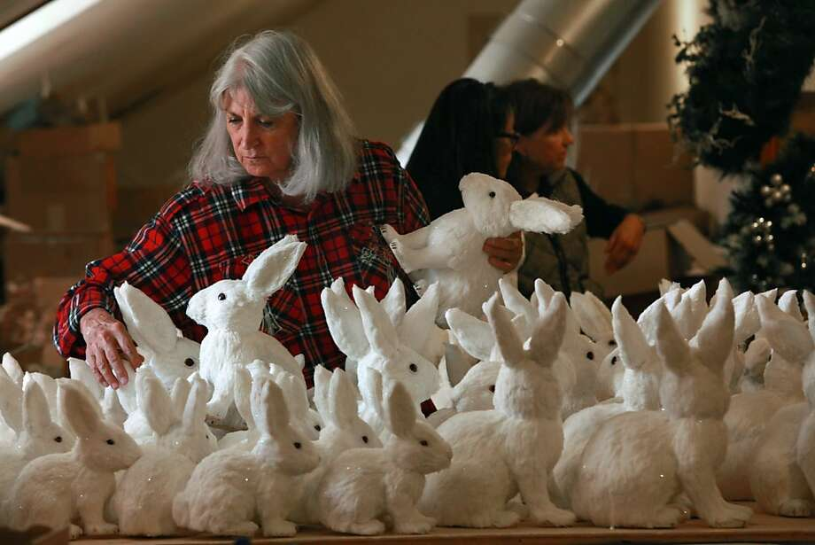 "At Filoli, Terry Dwight sorts snow bunnies from Kaemingk. ""Ice Fantasy"" is this year's holiday event theme at the mansion. Photo: Liz Hafalia, The Chronicle"
