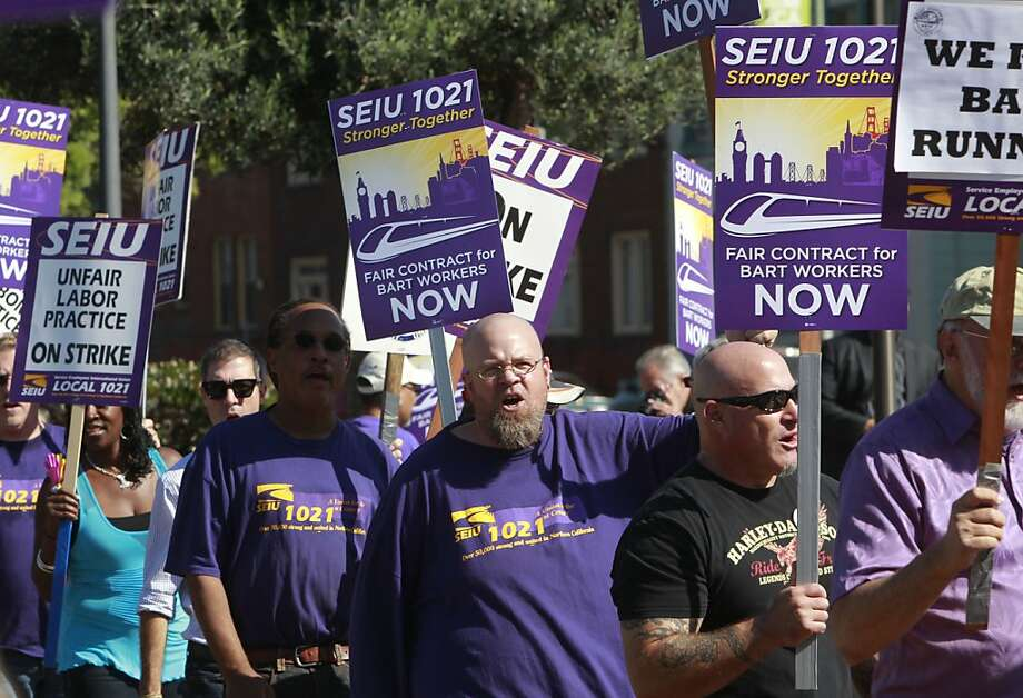 BART's union members join a noontime rally Friday at the Lake Merritt Station in Oakland. Local labor organizations appear to be standing firm behind BART's striking unions so far, but that could change if the walkout goes on for a long time. Photo: Michael Macor, The Chronicle