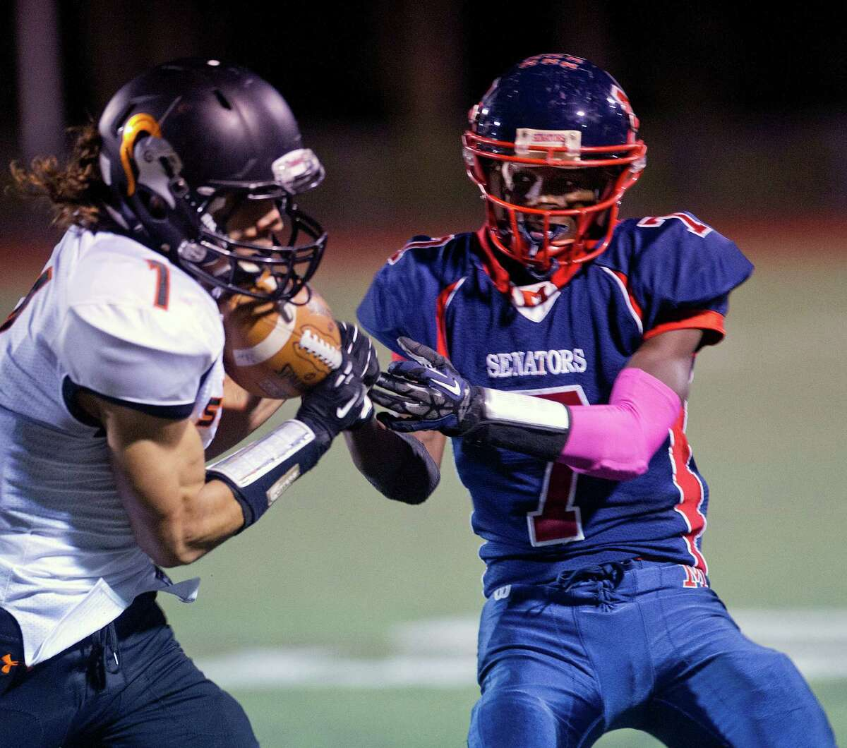 Stamford's Jake Bivona intercepts a ball meant for Brien McMahon's Kentrell Snider during Friday's football game in Norwalk, Conn., on October 18, 2013.