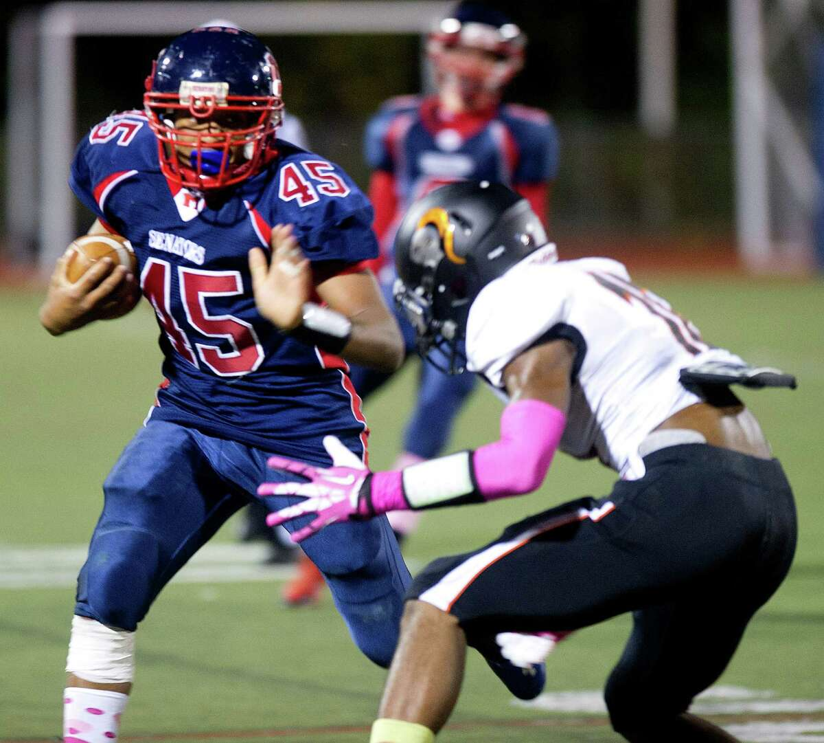 Brien McMahon's Kenneth Keen carries the ball during Friday's football game in Norwalk, Conn., on October 18, 2013.