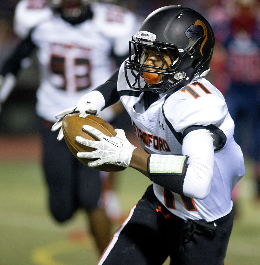 Stamford's Andrew Antoine carries the ball during Friday's football game in Norwalk, Conn., on October 18, 2013. Photo: Lindsay Perry / Stamford Advocate