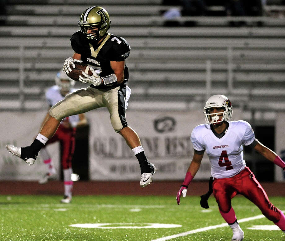 Trumbull's Thomas Hayduk intercepts a pass intended for Greenwich's Jose Melo, right, during football action in Trumbull, Conn. on Friday October 18, 2013. Photo: Christian Abraham / Connecticut Post