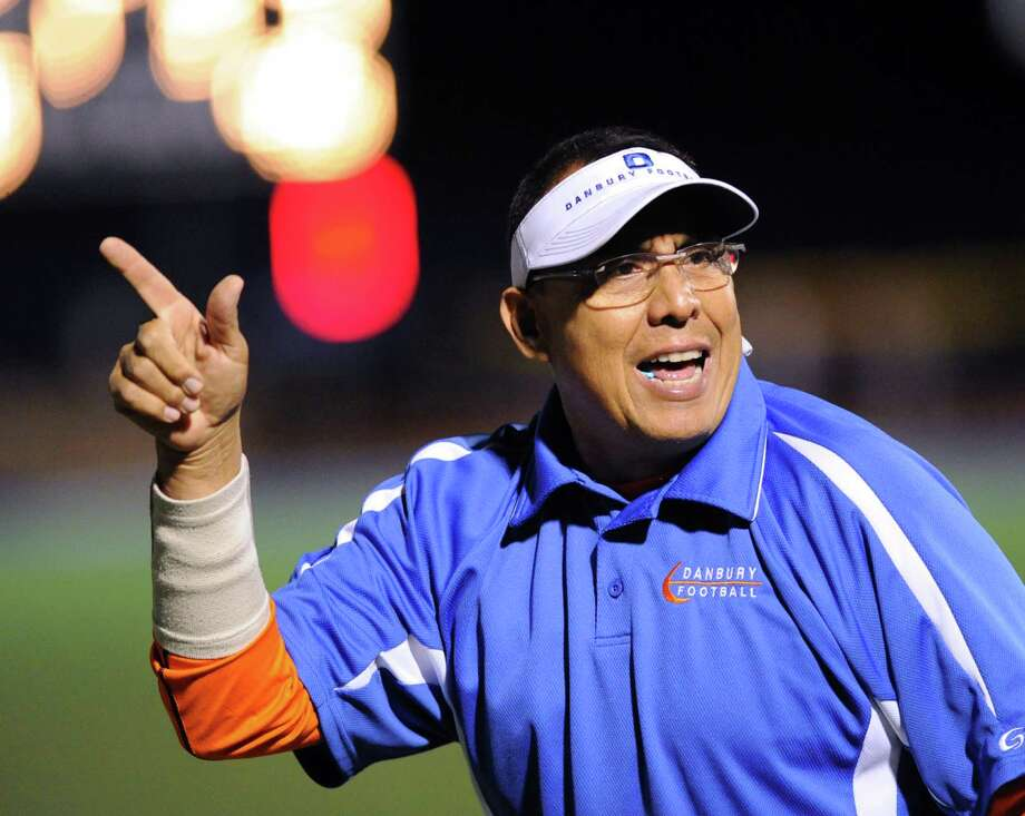 A Danbury football coach reacts to a Danbury touchdown during the high school football game between Staples High School and Danbury High School at Staples in Westport, Friday, Oct. 18, 2013. Photo: Bob Luckey / Greenwich Time