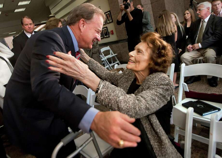 "Chancellor John Sharp hugs Macille Moore before Friday's ceremony honoring her late husband, state Sen. W.T. ""Bill"" Moore, at the main Texas A&M University campus in College Station. Photo: Stuart Villanueva/ The Eagle, MBR / Bryan College Station Eagle"