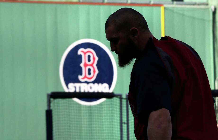 Boston Red Sox's Jonny Gomes heads to home plate to take batting practice during a team workout at Fenway Park, Friday, Oct. 18, 2013, in Boston. The Red Sox will face the Detroit Tigers in Game 6 of the American League baseball championship series on Saturday. (AP Photo/Charles Krupa) ORG XMIT: MACK103 Photo: Charles Krupa / AP