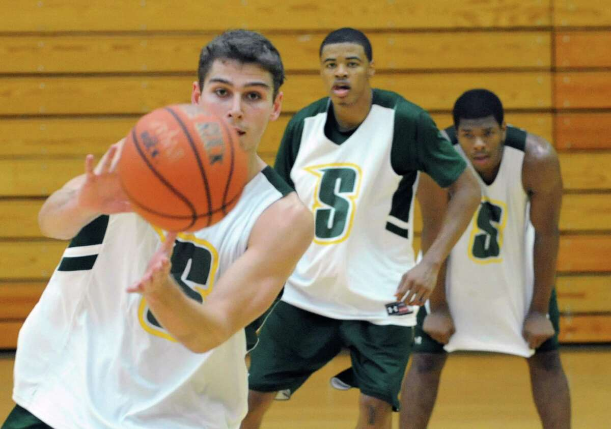 Siena basketball player Rob Poole recieves a pass during practice before media day on Friday, Oct. 18, 2013 in Loudonville, N.Y. (Lori Van Buren / Times Union)