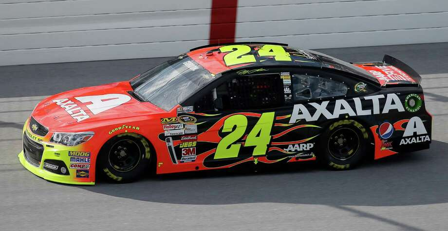 Driver Jeff Gordon races through the tri-oval during practice for Sunday's NASCAR Sprint Cup Series auto race at Talladega Superspeedway in Talladega, Ala., Friday, Oct. 18, 2013.(AP Photo/Dave Martin) ORG XMIT: ALDM115 Photo: Dave Martin / AP