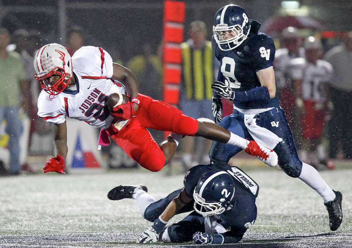 Judson's Cedric Williams (left) is tripped up by Smithson Valley's Shane Piatnik (below) as Connor Flanagan comes up to hep during the first half of their game at Ranger Stadium on Friday, Oct. 18, 2013. MARVIN PFEIFFER/ mpfeiffer@express-news.net