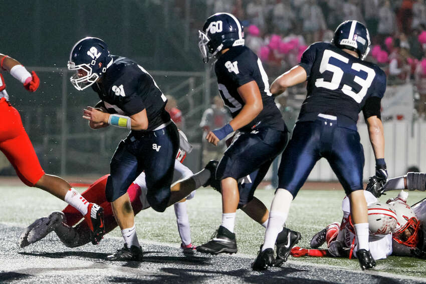 Smithson Valley's Garrett Smith (left) scores a touchdown during the first half of their game with Judson at Ranger Stadium on Friday, Oct. 18, 2013. MARVIN PFEIFFER/ mpfeiffer@express-news.net