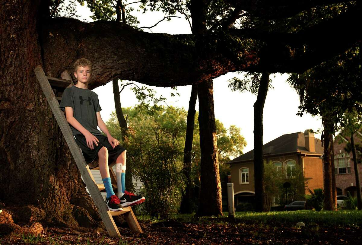Justin Davis, 12, can no longer climb trees after the onset of Giant Axonal Neuropathy, a rare, nerve-debilitating genetic disease.