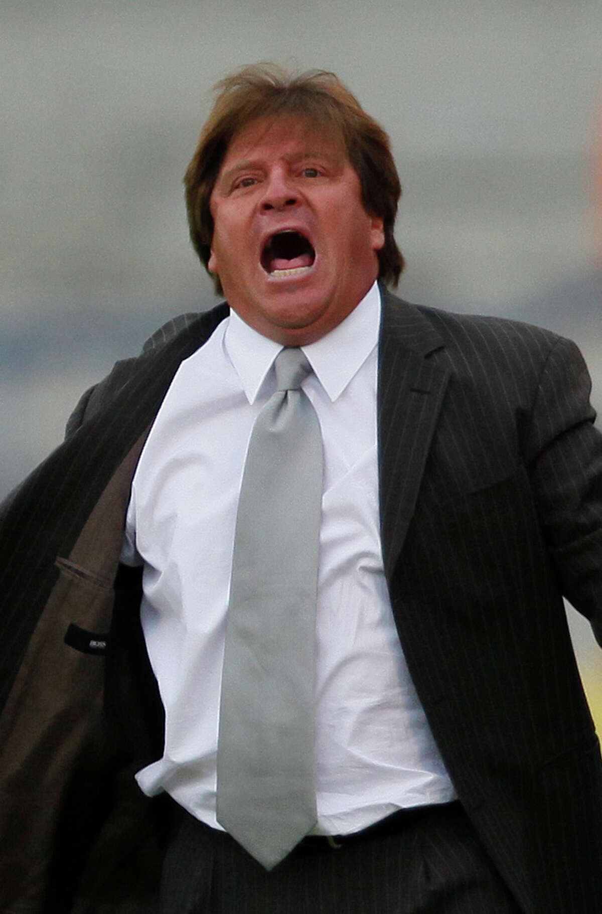 FILE - In this May 16, 2009 file photo, Tecos' soccer coach Miguel Herrera yells from the sidelines of a Mexican soccer league match against Pumas in Mexico City. Mexico's national soccer team named Herrera as its new coach on Friday, Oct. 18, 2013. (AP Photo/Claudio Cruz, File)