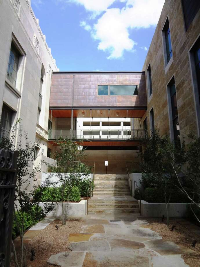 Visitors can enter the museum from the River Walk through this pathway, which has the old library building housing the Briscoe on the left and the new Guenther pavilion on the right. Photo: San Antonio Express-News