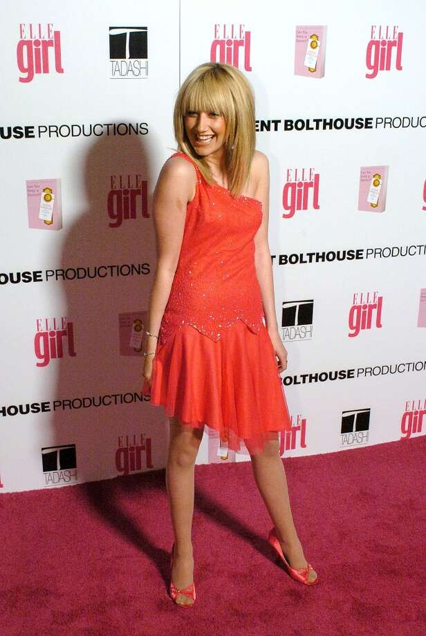 Actress Ashley Tisdale arrives at the First Annual ELLEGIRL Hollywood Prom party held at the Hollywood Athletic Club on April 14, 2005. (Photo by Phil McCarten/Getty Images) Photo: Phil McCarten, Getty Images / 2005 Getty Images