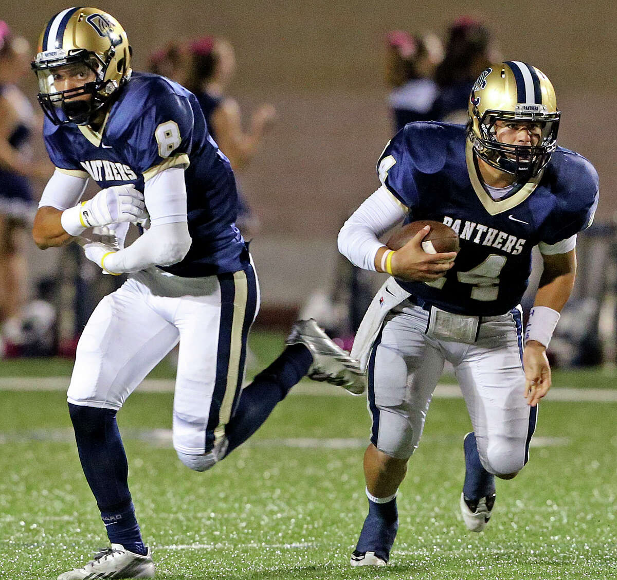 O'Connor quarterback Zach Galindo takes off with the ball after faking to Alonso Roscoe as Warren plays O'Connor at Farris Stadium on October 18, 2013.