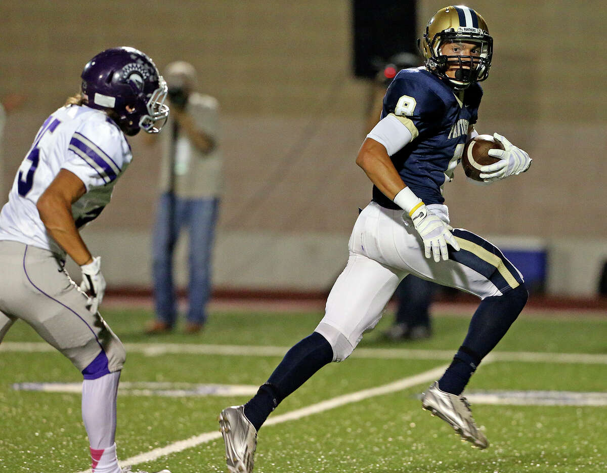 Panther receiver Alonso Roscoe takes off for the end zone for a touchdown after a catch in the first half as Warren plays O'Connor at Farris Stadium on October 18, 2013.