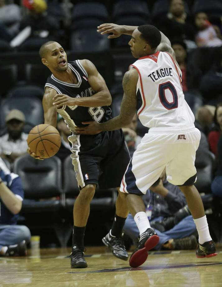 Patty Mills (left), likely the third point guard on the depth chart, has played as if he'd do just fine as the main backup. Photo: John Bazemore / Associated Press