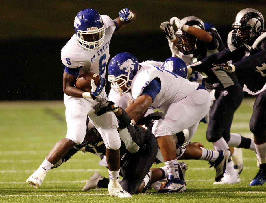 Cy-Creek Terrell Aldridge (6) breaks the tackle of Cy-Ridge's Anthony Jacobs during the first half of a high school football game, Friday, October 18, 2013 at Pridgeon Stadium in Houston. Photo: Eric Christian Smith, For The Chronicle