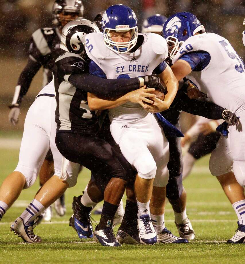 Cy-Creek quarterback Luke Allen (30) is sacked by Cy-Ridge's Donovan Williams during the first half of a high school football game, Friday, October 18, 2013 at Pridgeon Stadium in Houston. Photo: Eric Christian Smith, For The Chronicle