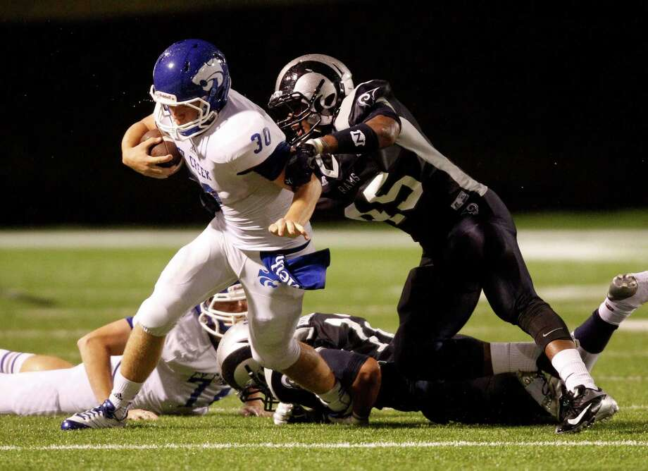 Cy-Creek quarterback Luke Allen (30) is tackled by Cy-Ridge's Anthony Jacobs during the first half of a high school football game, Friday, October 18, 2013 at Pridgeon Stadium in Houston. Photo: Eric Christian Smith, For The Chronicle