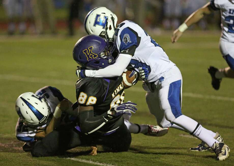 10/18/13: Kinkaid Flacons  Mavin Saunders (88) is tackled by Episcopal Knights Ross Pellegrin (28) in a high school football game at Kinkaid School in Houston, Texas. Photo: Thomas B. Shea, Houston Chronicle / © 2013 Thomas B. Shea