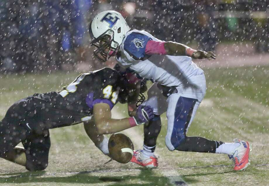10/18/13: Episcopal Knights Tyreik Gray (7) fumbles the ball after being hit by Kinkaid Flacons Joe Beeler (44) in a high school football game at Kinkaid School in Houston, Texas. Photo: Thomas B. Shea, Houston Chronicle / © 2013 Thomas B. Shea