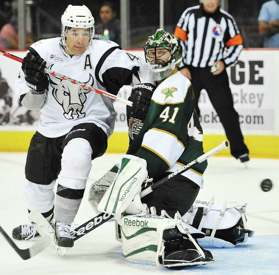 Rampage right wing Jed Ortmeyer (left) tussles with Texas goaltender Christopher Nilstorp during the second period at the AT&T Center. Garrett Wilson scored for the Rampage. Photo: Darren Abate / For The Express-News
