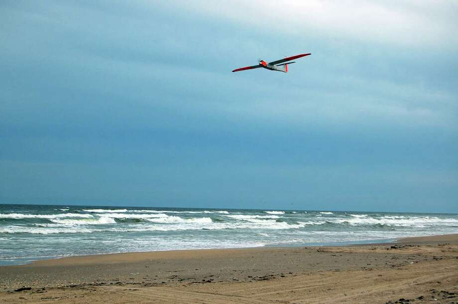 Researchers at Texas A&M-Corpus Christi, who have been carrying out drone tests for two years, launched the RS-16 unmanned aerial vehicle on the Padre Island National Seashore in October 2011. / Texas A&M University Corpus Christi