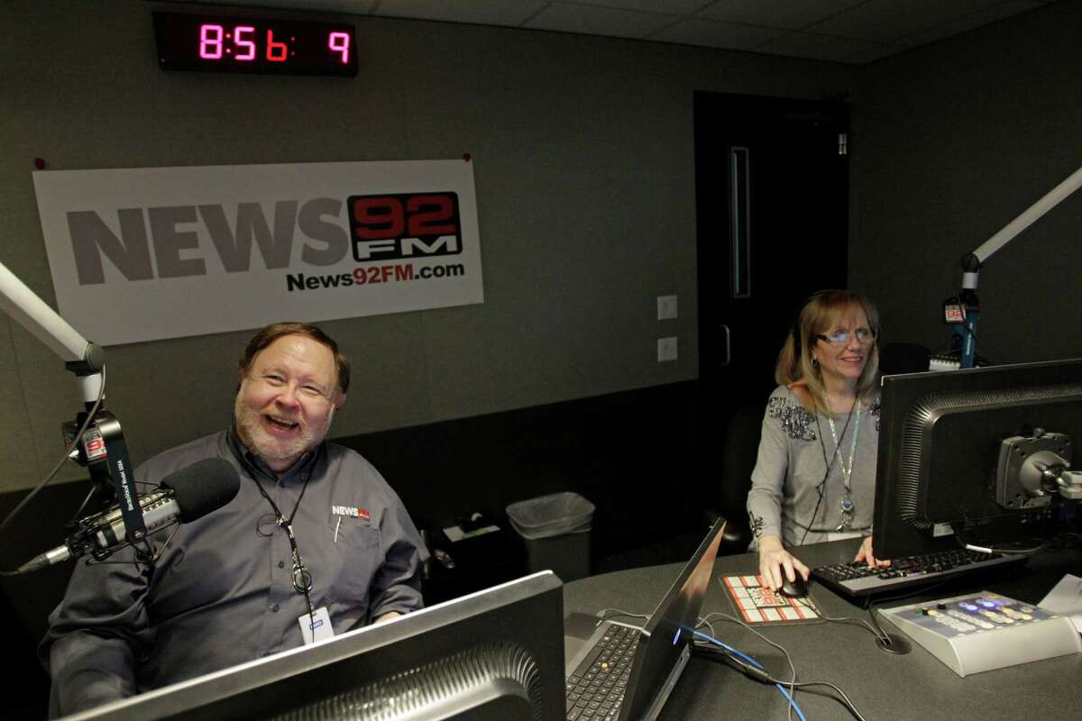 JP Pritchard, left, and Lana Hughes, right, broadcast during the News 92 FM radio morning news Tuesday, Oct. 15, 2013, in Houston. ( Melissa Phillip / Houston Chronicle )