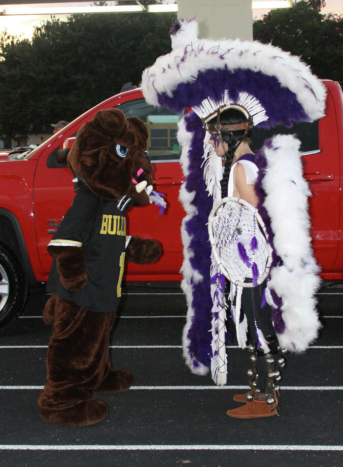 The Nederland Bulldog and the PNG Indian square off before the start of the Mid-County Madness game Friday at Bulldog Stadium in Nederland. (Matt Billiot / Special to the Enterprise)