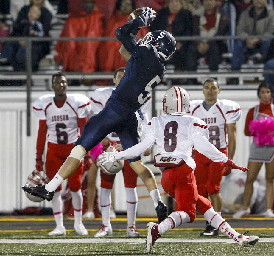 Smithson Valley's Joseph Barsalou (5) comes up with a first-down reception in front of Judson's Dominic Cameron on Friday. The Rockets, who haven't had a losing season since 1976, were trying to set the state record for consecutive winning seasons. Photo: Marvin Pfeiffer / San Antonio Express-News