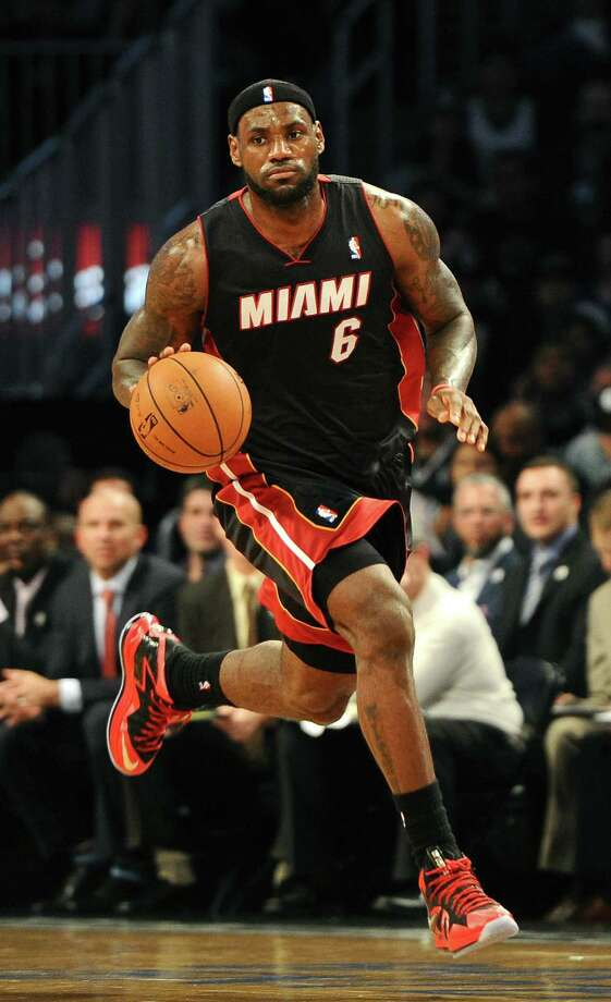 LeBron James and Miami won a hard-fought Finals against the Spurs, who have been haunted since.