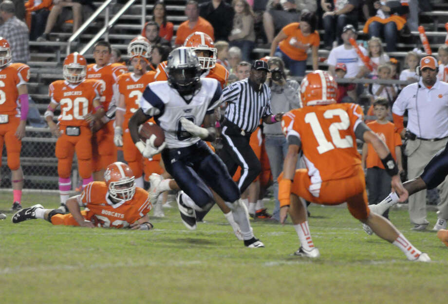 West Orange-Stark's Deionte' Thompson, 6, runs back towards the middle, against Orangefield, during the game Friday at F.L. McClain Stadium. (William Jones / Special to the Enterprise)