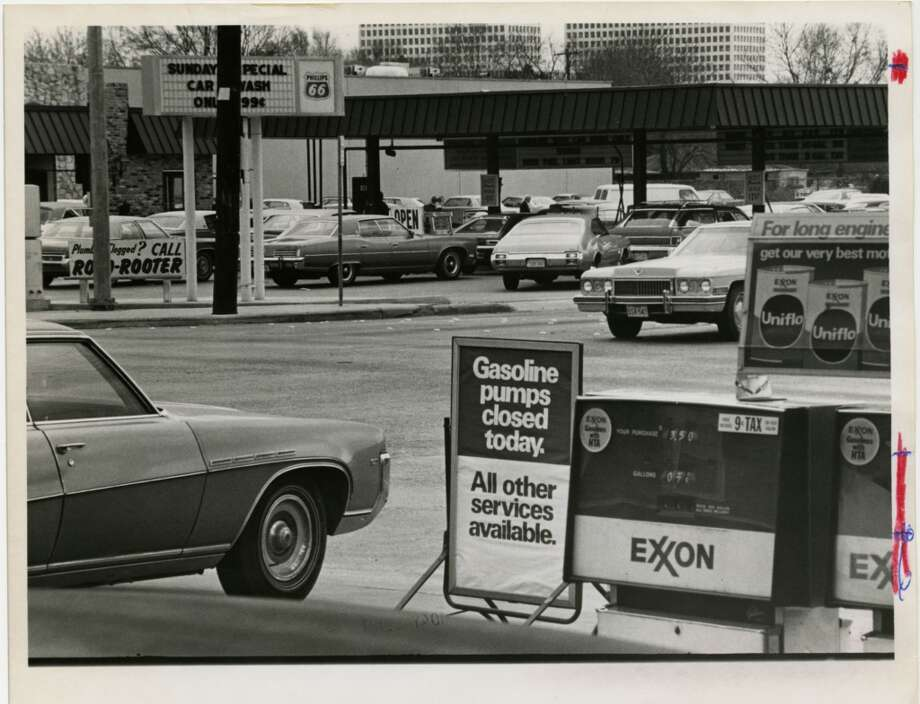 On March 1, 1974, an  Exxon station had no fuel for their gasoline pumps, while a station across the street received plenty of business. Photo: Jerry Click, Houston Chronicle