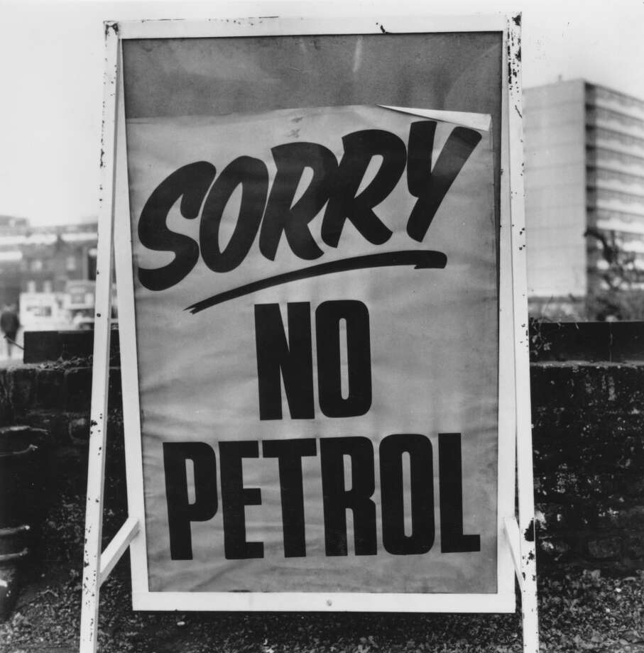 A sign stands outside of a garage in South London during the fuel crisis of 1973. Petrol coupons were issued by the government in readiness for rationing. Photo: Evening Standard, Getty Images