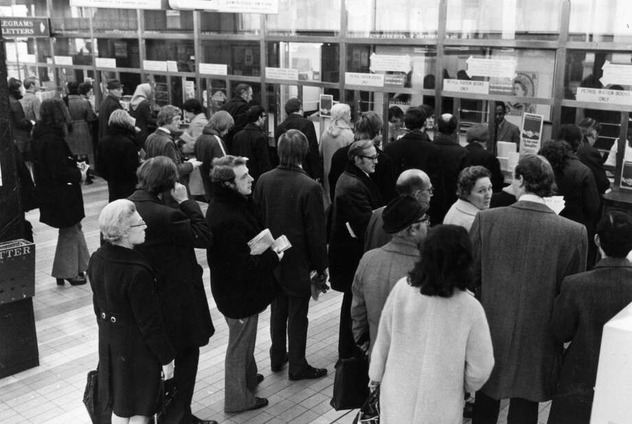 Motorists line up at the post office in Trafalgar Square, London, to collect their petrol coupons during the fuel shortage crisis of 1973. Photo: Sydney O'Meara, Getty Images