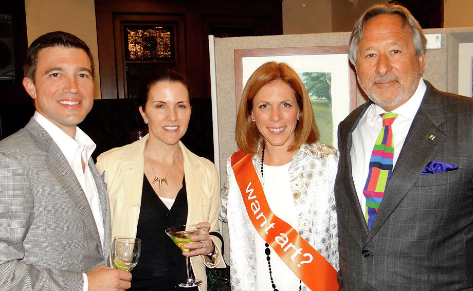 Andrew Shantz, Kathleen Friedler and Lauren Pinto with Dr. Philip Eliasoph, honorary chairman of the Pequot Library's annual art show at the Friday preview party. Photo: Mike Lauterborn / Fairfield Citizen contributed
