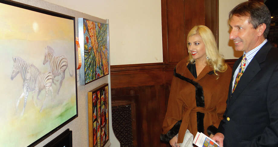 Michelle and Paul Fattibene of Southport at Friday's preview for the Pequot Library's annual Art Show. Photo: Mike Lauterborn / Fairfield Citizen contributed