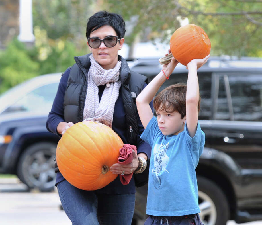Elena Rawley of Old Greenwich and her son, Hayden, 7, pick pumpkins during the Old Greenwich School Pumpkin Patch event at the school in Old Greenwich, Saturday, Oct. 19, 2013. Photo: Bob Luckey / Greenwich Time
