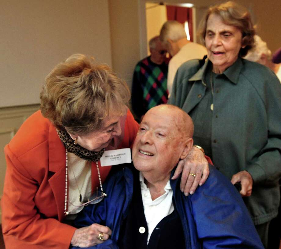 Millie Godfrey, left, greets Don and Jackie Wetmore as the Danbury High School class of 1948 holds its 65th reunion Saturday, Oct. 19, 2013, at Anthony's Lake Club, in Danbury, Conn. Photo: Michael Duffy / The News-Times