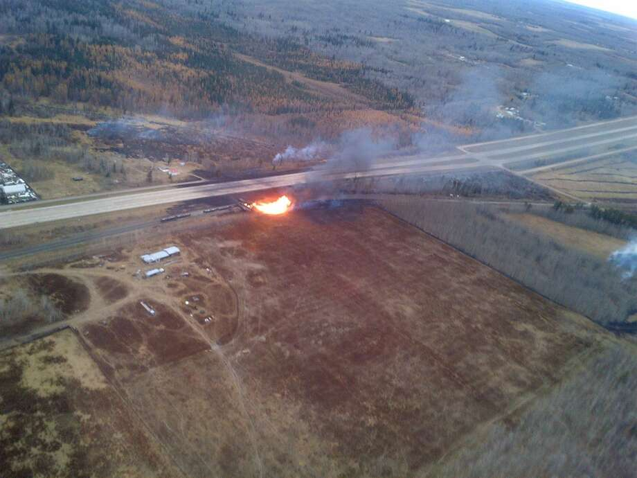 Emergency crews work a massive fire after a CN tanker train carrying oil and gas derailed in Gainford, Alberta, Canada, west of Edmonton on Saturday, Oct. 19, 2013.  Canadian National spokesman Louis-Antoine Paquin said 13 cars, four carrying petroleum crude oil and nine loaded with liquified petroleum gas, came off the tracks around 1 a.m. local time in the hamlet of Gainford, about 50 miles (80 kilometers) from Edmonton. The entire community of roughly 100 people was evacuated. Photo: Royal Canadian Mounted Police, ASSOCIATED PRESS
