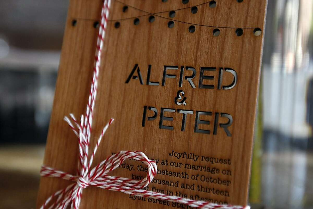 A small plaque announces the wedding of Alfred and Peter at their reception space in San Francisco, CA Saturday, October 19, 2013. Peter Wagner and Alfred Cheung's wedding will allow Alfred, an immigrant who arrived from Hong Kong more than 20 years ago, to finally bring his business and nonprofit out from the shadows.