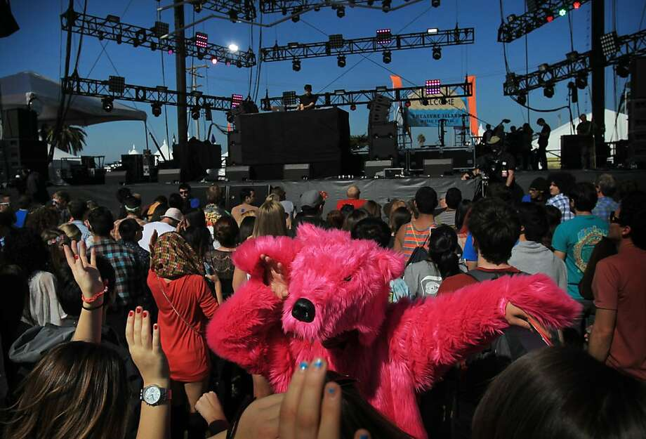 Matt Lock, 28, center in bear suit, dances to Giraffage during the Treasure Island Music Festival October 19, 2013 on Treasure Island in San Francisco, Calif. Photo: Leah Millis, The Chronicle