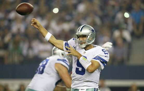 Dallas Cowboys quarterback Tony Romo (9) passes during an NFL football game against the Washington Redskins Sunday, Oct. 13, 2013, in Arlington, Texas. (AP Photo/Tim Sharp) Photo: Tim Sharp, Associated Press / FR62992 AP