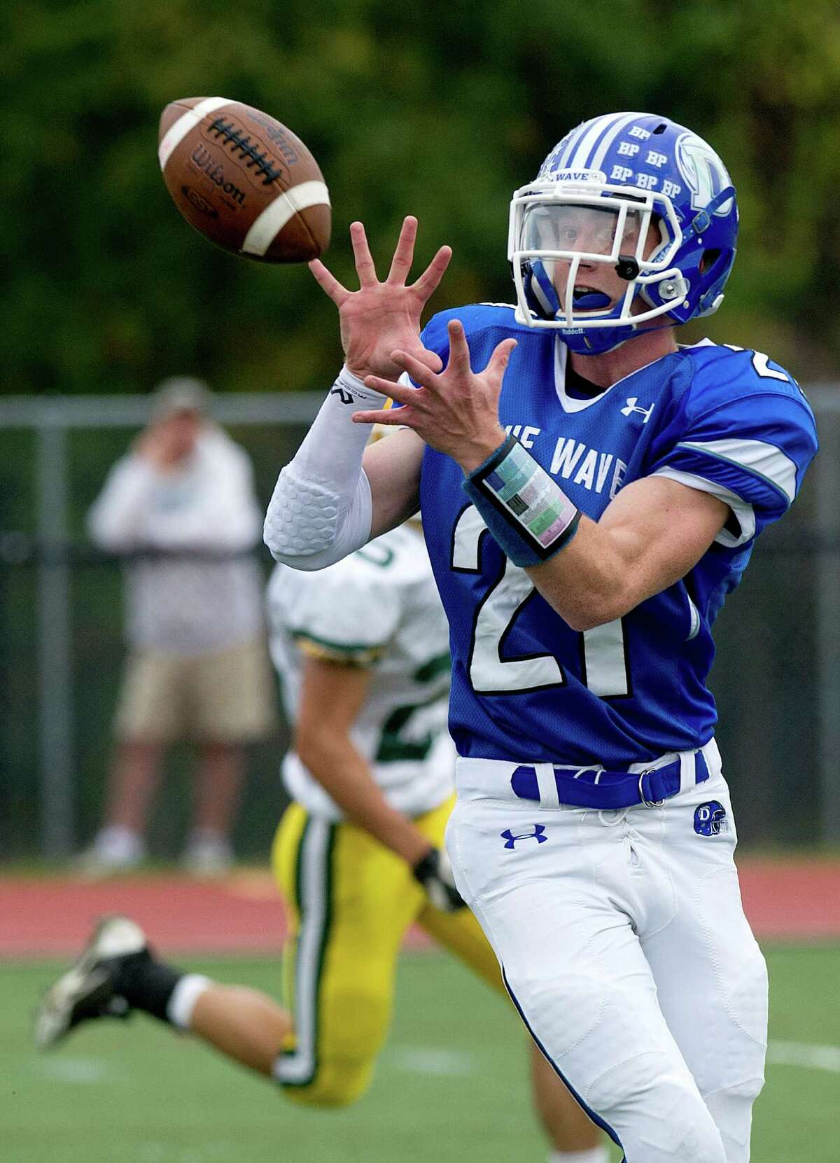 Darien's Nicholas Lombardo makes a catch and runs for a touchdown during Saturday's football game at Darien High School on October 19, 2013.